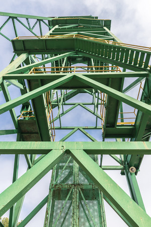 disuse: Green tower of a well extraction of a mine of salt in disuse in Cardona, Catalonia, Spain