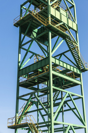 Green tower of a well extraction of a mine of salt or potash in disuse in Cardona, Catalonia, Spain Stock Photo
