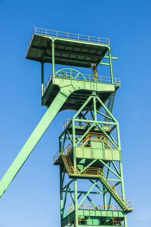 disuse: Green tower of a well extraction of a mine of salt or potash in disuse in Cardona, Catalonia, Spain Stock Photo