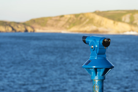 Blue panoramic telescope with the sea as background in Spain Stock Photo
