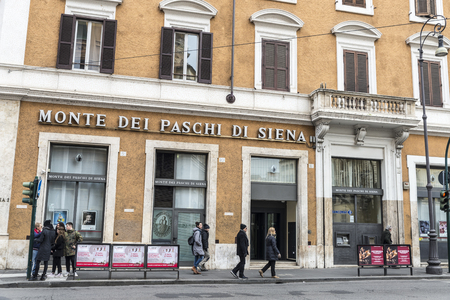 bank branch: Rome, Italy - January 2, 2017: People walking in front of Monte dei Paschi di Siena bank branch in Rome. MPS is the oldest bank in the world founded in 1472