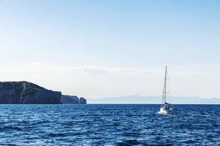 Sailboat sailing with people at the Costa Brava, Girona, Catalonia, Spain