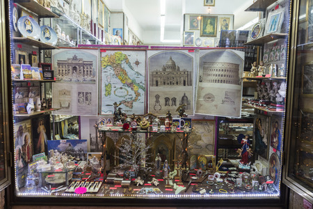 Rome, Italy - December 29, 2016: Souvenir shop with gifts, maps and religious figures in the historical center of Rome, Italy Redakční
