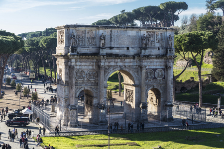 Rome, Italy - December 31, 2016: Arch of triumph known as Arch of Constantine full of tourists in Rome, Italy