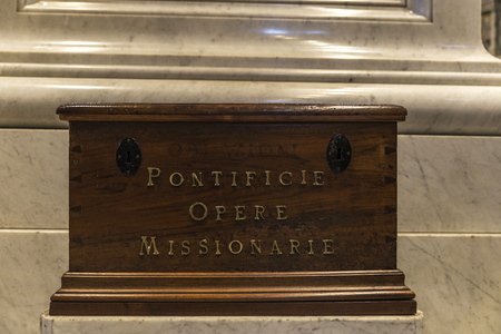 Vatican City, Vatican - January 4, 2017: A donation box for missionaries in the interior of Papal basilica of Saint Peter in Vatican City