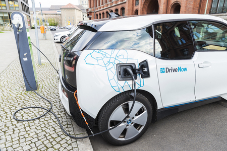 Berlin, Germany - April 14, 2017: Electric car, model BMW i3, of a company of carsharing called Drivenow recharging the batteries in Berlin, Germany
