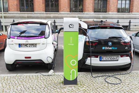 i3: Berlin, Germany - April 14, 2017: Electric cars, models BMW i3 and Citroen C Zero, two carsharing companies called Drivenow and Multicity Carsharing recharging batteries at a recharge point of the company Innogy in Berlin, Germany