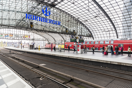 Berlin, Germany - April 12, 2017: Passengers waiting a train in Berlin Central Station, the main railway station in Berlin, Germany