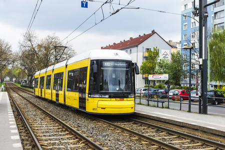 Berlin, Germany - April 12, 2017: Yellow tram stopped on a platform in Berlin, Germany
