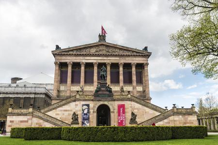 alte: Berlin, Germany - April 13, 2017: Alte Nationalgalerie (Old National Gallery) of Berlin in Museum Island with people walking around in Berlin, Germany.