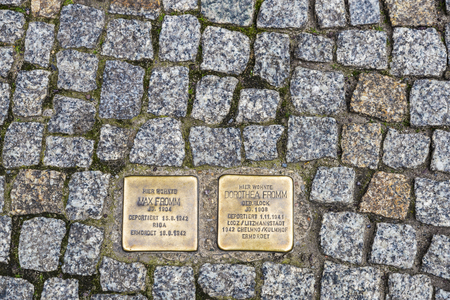 casualty: Berlin, Germany - April 14, 2017: Plaques reminiscent of Jewish victims of the Holocaust on a street in Berlin, Germany Editorial