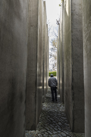 Berlin, Germany - April 14, 2017: The Garden of Exile with a man walking in the Jewish Museum in Berlin, Germany