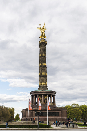 Berlin, Germany - April 14, 2017: People walking around the Victory Column (Siegessaule) in Berlin, Germany. It is a monument to commemorate the Prussian victory in the Danish-Prussian War in Berlin, Germany.