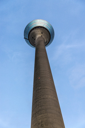 Telecommunications tower against the blue sky in Dusseldorf, Germany Stock Photo