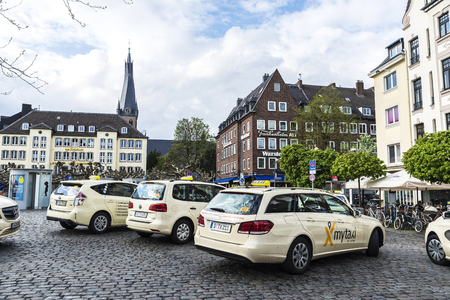 Dusseldorf, Germany - April 16, 2017: Taxi stop in Burgplatz. It is a square next to the river Rhine with bar in Dusseldorf, Germany Editorial