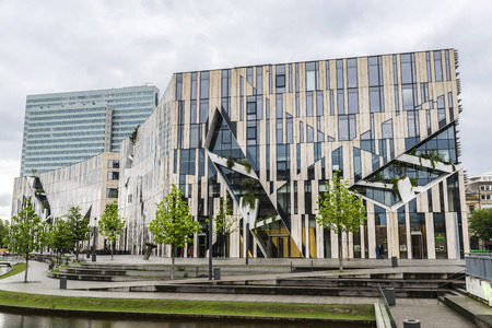 Dusseldorf, Germany - April 16, 2017: Facade of a modern buildings with a Rolex watch shop in Dusseldorf, Germany Editorial