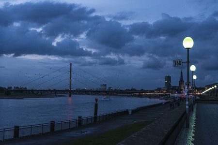 View of the promenade and the Oberkassel bridge at night in Dusseldorf, Germany