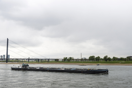 merchant: Cargo ship sailing on the Rhine River in Dusseldorf, Germany