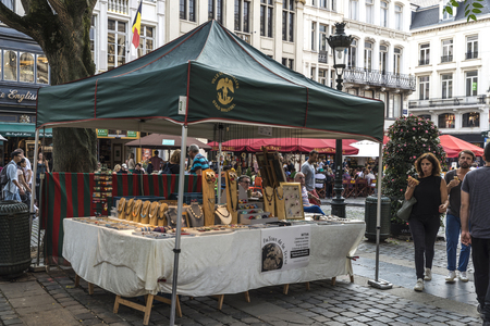 Brussels, Belgium - August 26, 2017: Flea market in a square in the old town called Agoraplein with people walking around in Brussels, Belgium