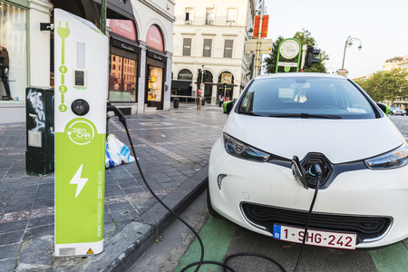 Brussels, Belgium - August 27, 2017: Electric car recharging batteries at a recharge point of the company Zen Car on a street in Brussels, Belgium