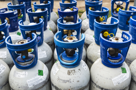 Brussels, Belgium - August 27, 2017: Refrigerant gas cylinders under pressure of the Luxfer brand ready to transport in Brussels, Belgium