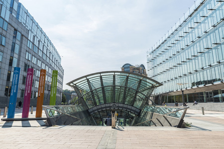 Brussels, Belgium - August 28, 2017: Subway station and the modern office buildings of the European Parliament with people walking in Brussels, Belgium Editorial