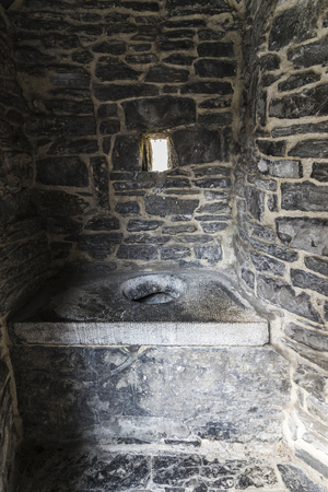 Latrine in the Gravensteen medieval castle in the old town of the city of Ghent, Belgium