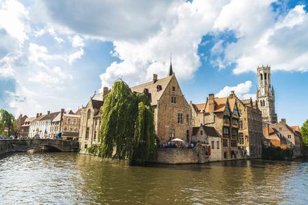 Bruges, Belgium, - August 31, 2017: Rozenhoedkaai or Rosary Dock with people around in the medieval city of Bruges, Belgium