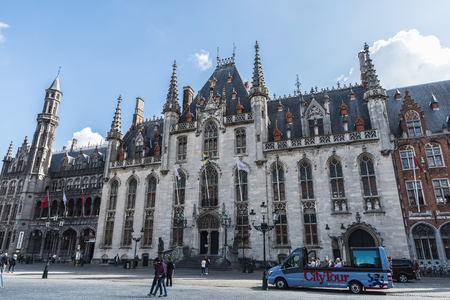 Bruges, Belgium, - August 31, 2017: The Provinciaal Hof (Province Court), on the market place of Bruges with people around in Belgium Editorial