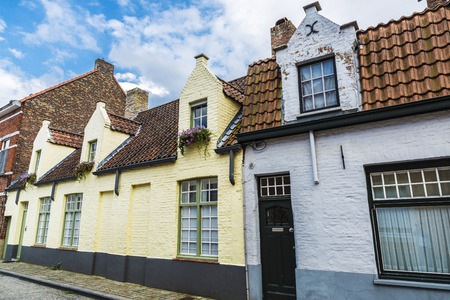 Facade of old historic buildings in the medieval city of Bruges, Belgium Stock Photo