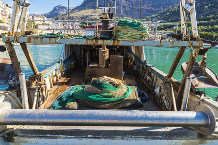 Fishing port with old fishing boats docked at the marina in summer in Castellammare del Golfo in Sicily, Italy