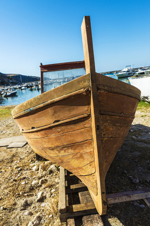 Old wooden fishing boat moored on the beach in summer in Castellammare del Golfo in Sicily, Italy Stock Photo