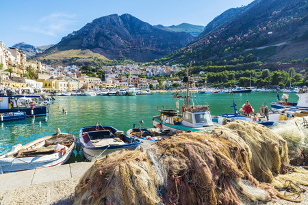 View of Castellammare del Golfo with its marina with fishing boats and yachts in summer in Sicily, Italy