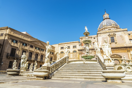 The Praetorian Fountain (Fontana Pretoria) with the dome of Santa Caterina in the background is a monumental fountain that represents the Twelve Olympians, other mythological figures, animals and the rivers of Palermo located in the old town of Palermo in Sicily, Italy