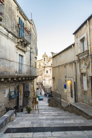 Street of the old town with steps of the historic village of Ragusa in Sicily, Italy