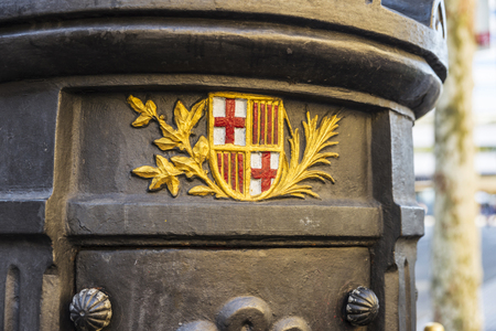 Shield of Barcelona in the Font de Canaletes, ornate fountain crowned by a lamp post, in Les Rambles of Barcelona, Catalonia, Spain Banco de Imagens