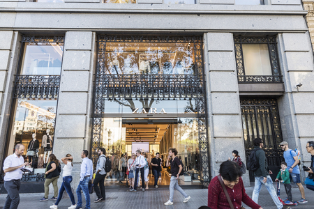 Barcelona, Spain - September 20, 2017: Zara shop with people around in the center of Barcelona in Catalonia, Spain