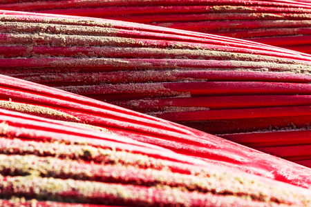 Heap of red kayaks or boats of plastic as abstract background Stock Photo