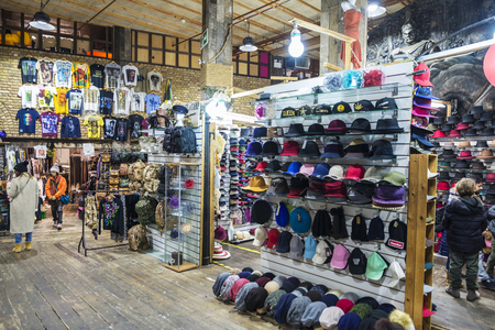 London, United Kingdom  - December 31, 2017: Fashion shops in Camden Lock Market or Camden Town with people around in London, England, United Kingdom