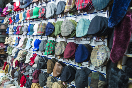 London, United Kingdom - December 31, 2017: Display of a millinery shop with hats, berets and caps in Camden Lock Market or Camden Town in London, England, United Kingdom