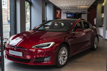 Amsterdam, Holland - September 9, 2018: Red electric car Model S of the Tesla brand in a Tesla Motors car dealership in Amsterdam, Holland