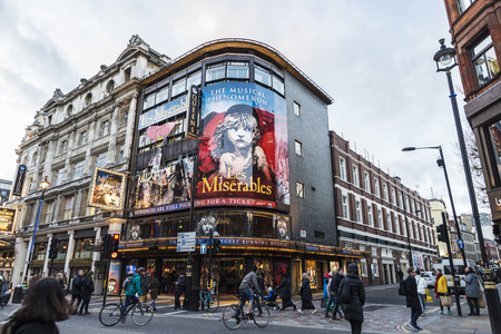 London, United Kingdom - January 4, 2018: Facade of the Queen's Theatre announcing the play Les Miserables in Shaftesbury Avenue, major street in the West End in London, England, United Kingdom Editorial