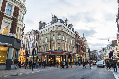 London, United Kingdom - January 4, 2018: People walking down the shops and restaurants of Shaftesbury Avenue, major street in the West End in London, England, United Kingdom