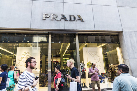 New York City, USA - July 28, 2018: Prada, luxury clothing store, in Fifth Avenue (5th Avenue) with people around in Manhattan in New York City, USA Editorial