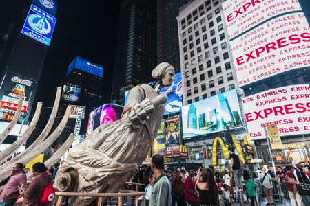 New York City, USA - July 30, 2018: Unmoored, massive animatronic sculpture by Mel Chin, in Times Square at night with people around and large advertising screens in Manhattan in New York City, USA Editorial