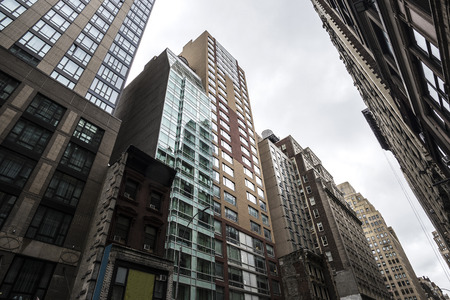 Facade of a modern and classic skyscrapers in Manhattan in New York City, USA