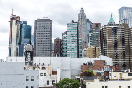Modern skyscrapers, roof top of buildings and an old water tank in Manhattan in New York City, USA