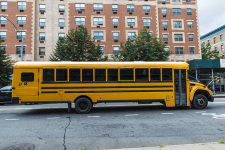 Yellow school bus in Harlem, Manhattan, New York City, USA