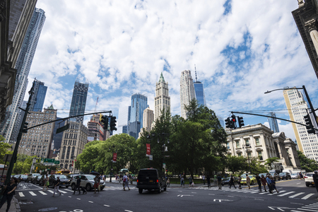 New York City, USA - July 27, 2018: Skyscrapers in Centre Street and City Hall Park with people around in Manhattan, New York City, USA Editorial