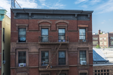 Old typical houses in the Harlem neighborhood in Manhattan, New York City, USA Stock Photo